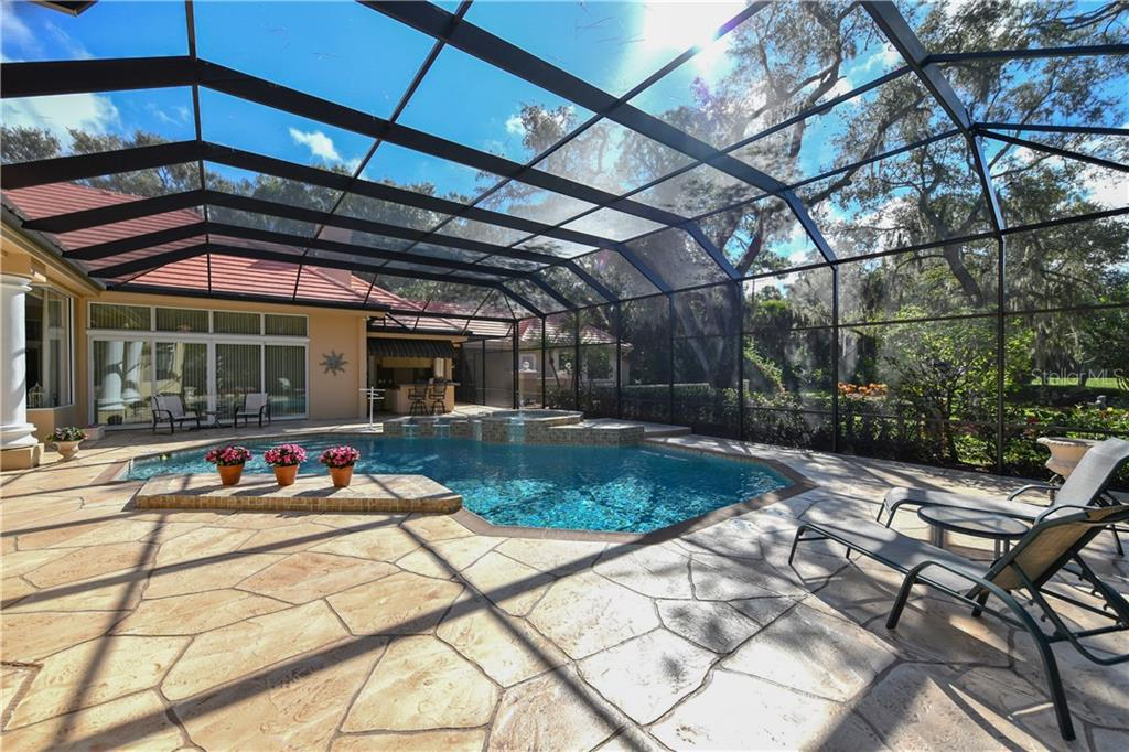 Caged Pool and Sun Bathing Deck - Single Family Home for sale at 7659 Alister Mackenzie Dr, Sarasota, FL 34240 - MLS Number is A4416607