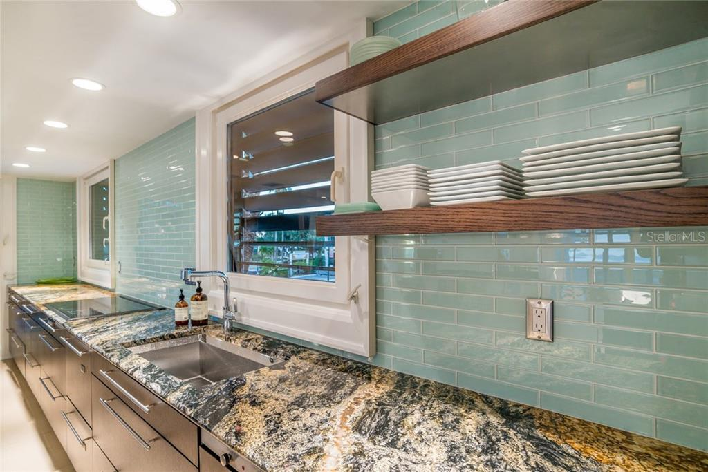 Glass subway tile & exotic granite in kitchen - Townhouse for sale at 222 Beach Rd #4, Sarasota, FL 34242 - MLS Number is A4416747