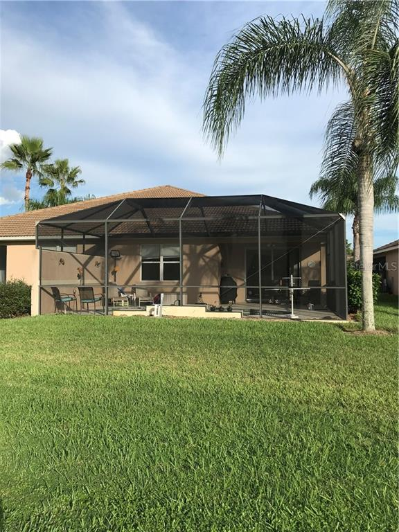 Back of the home. - Villa for sale at 252 Fairway Isles Ln, Bradenton, FL 34212 - MLS Number is A4417217