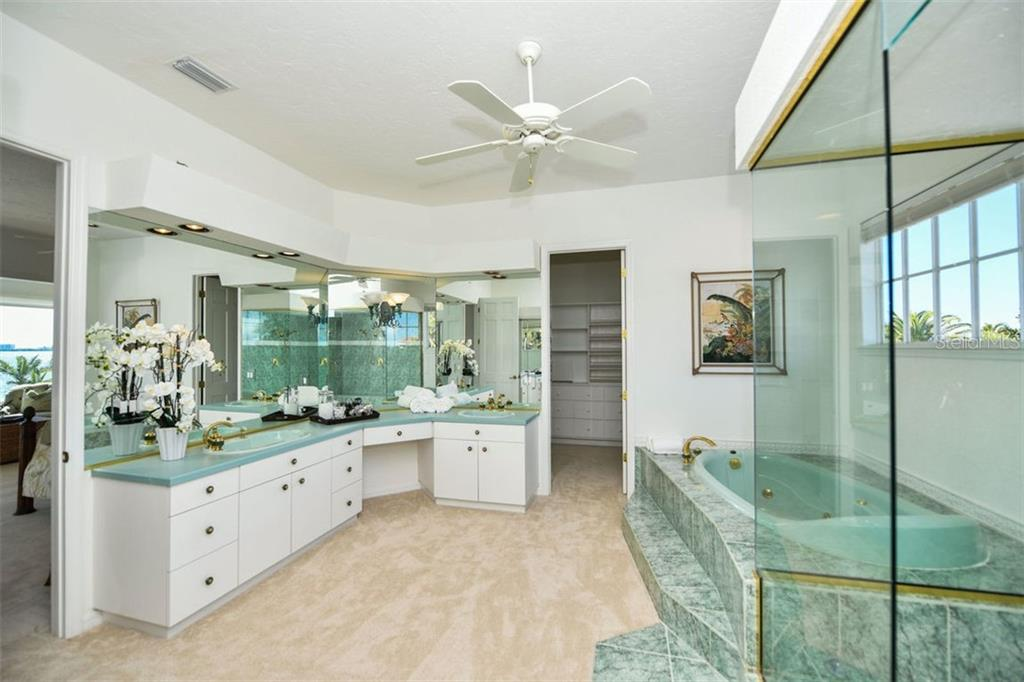 Master bath, double sinks, soaker tub, walk-in shower, toilet and bidet. - Single Family Home for sale at 7689 Cove Ter, Sarasota, FL 34231 - MLS Number is A4417242