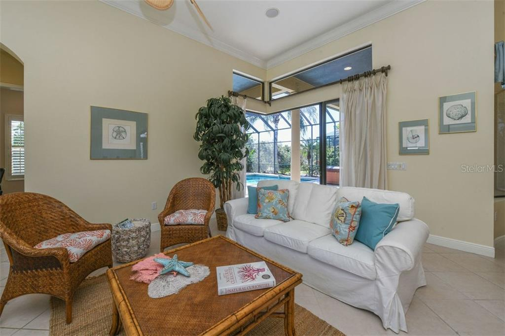 Spacious Great Room with Corner Sliders Open to Lanai & Pool - Single Family Home for sale at 7060 Whitemarsh Cir, Lakewood Ranch, FL 34202 - MLS Number is A4417363