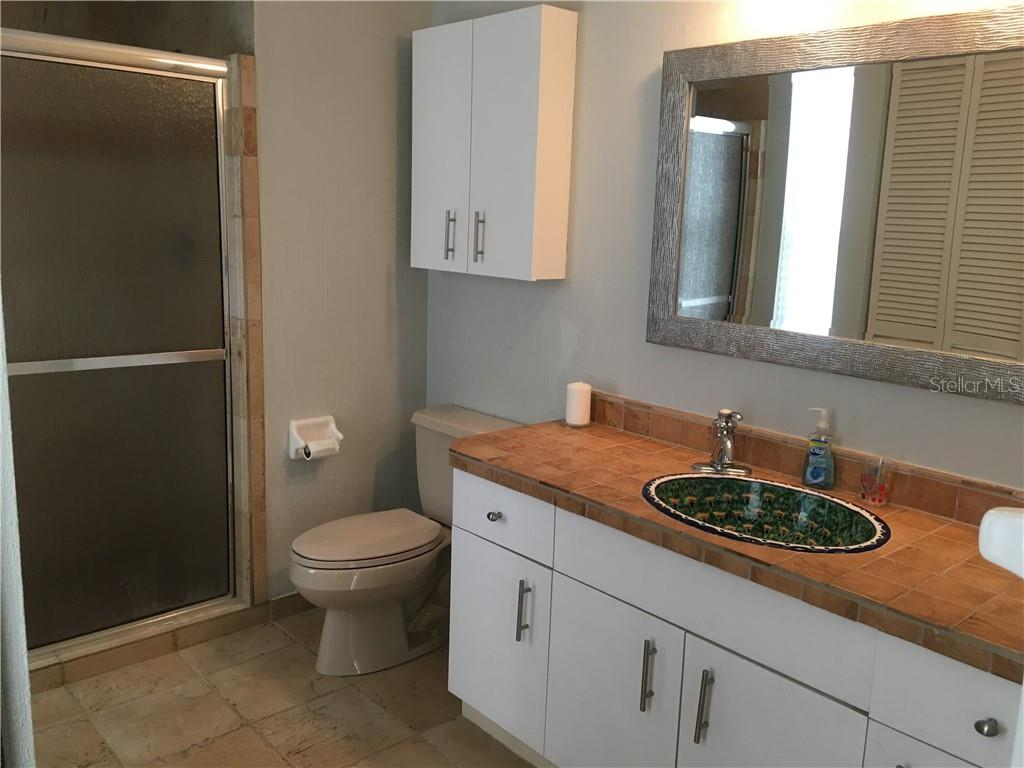 Master bath has updated stall shower and decorative sink. - Single Family Home for sale at 1611 82nd St Nw, Bradenton, FL 34209 - MLS Number is A4417607
