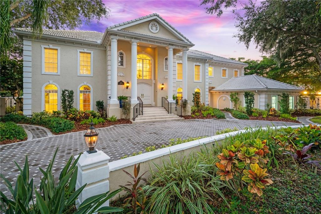 "This Grand Estate home, once remarked as the ""White House of Sarasota"" is a landmark in The Landings, a picturesque"