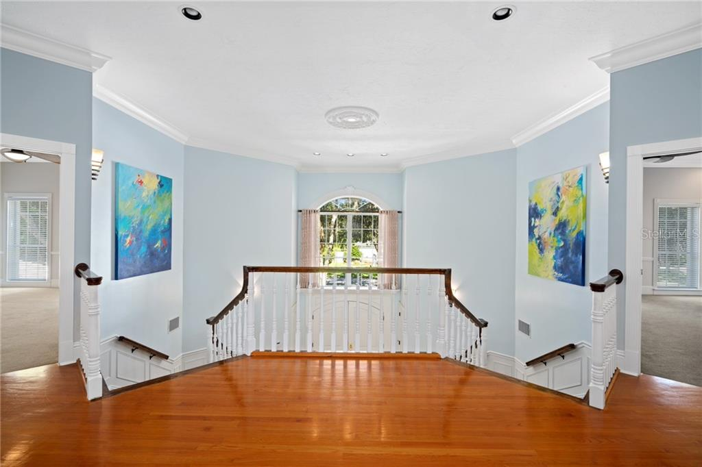 Second level landing above the Double Grand Staircase. The second floor hosts five spacious bedrooms with elevated ceilings, large windows, walk-in closets and lovely ensuites. - Single Family Home for sale at 1654 Landings Blvd, Sarasota, FL 34231 - MLS Number is A4417765