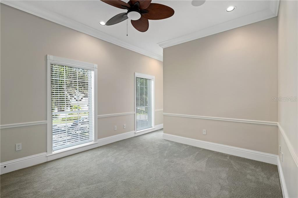 Guest Bedroom #3, with high ceilings, recessed Lutron lighting, large windows, Ensuite and a walk-in closet. - Single Family Home for sale at 1654 Landings Blvd, Sarasota, FL 34231 - MLS Number is A4417765