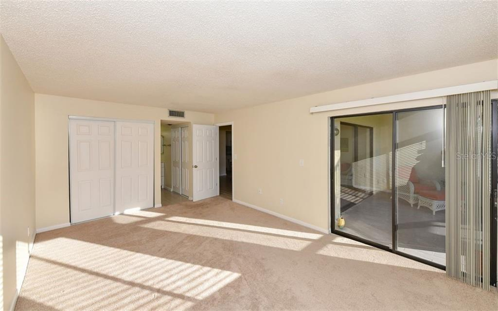 Master Bedroom w/sliding door to lanai - Condo for sale at 4576 Longwater Chase #59, Sarasota, FL 34235 - MLS Number is A4418168