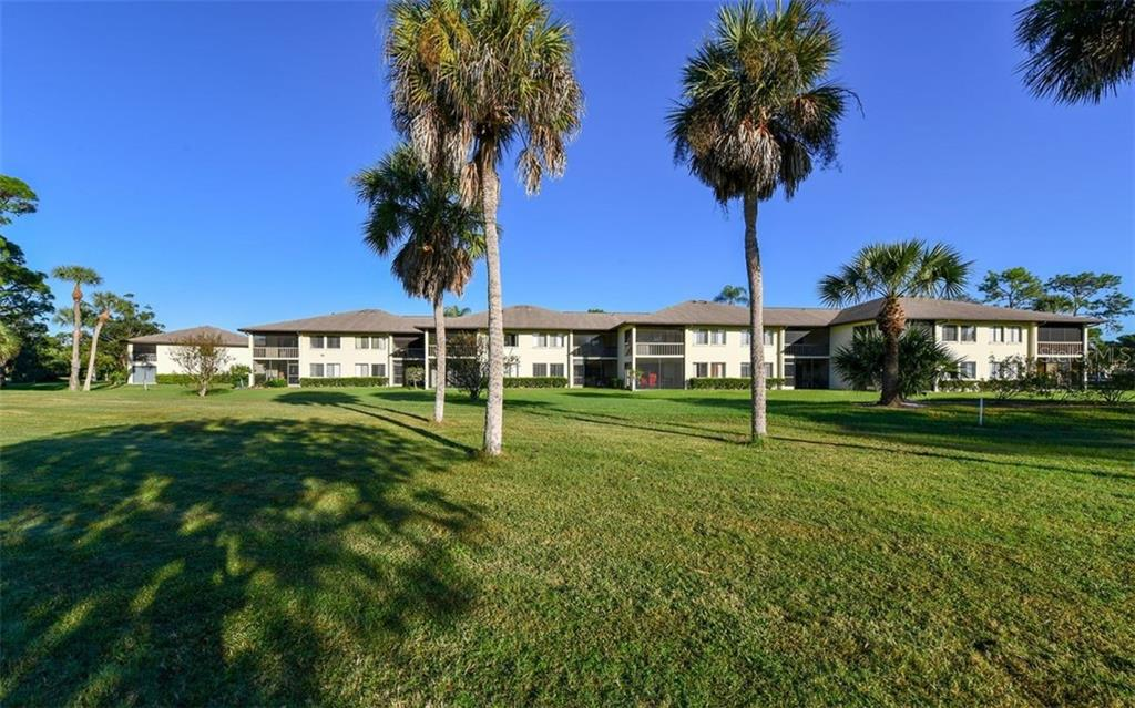 View from behind the building - Condo for sale at 4576 Longwater Chase #59, Sarasota, FL 34235 - MLS Number is A4418168