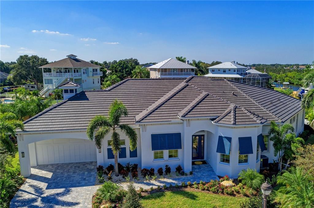 Medallion Home's Custom furnished model home with dock on saltwater canal available in Harbour Walk in The Inlets. - Single Family Home for sale at 4702 Mainsail Dr, Bradenton, FL 34208 - MLS Number is A4418183