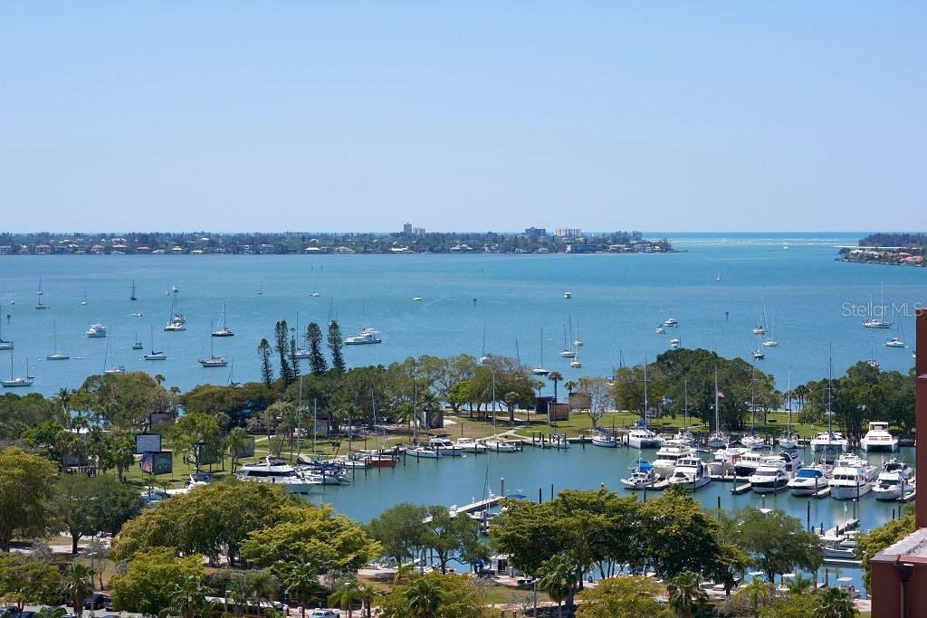 Looking over Marina Jacks and the marina to Sarasota Bay. - Condo for sale at 1350 Main St #1406, Sarasota, FL 34236 - MLS Number is A4418200