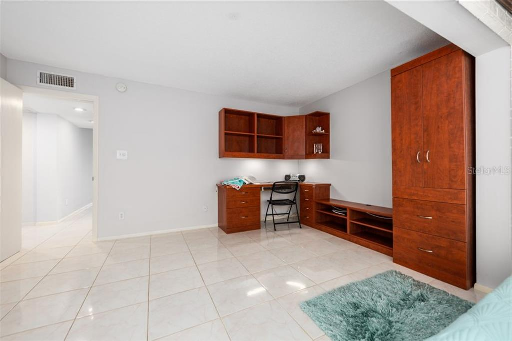 Built in desk. A private area to do some paperwork. - Condo for sale at 450 Gulf Of Mexico Dr #b107, Longboat Key, FL 34228 - MLS Number is A4418457