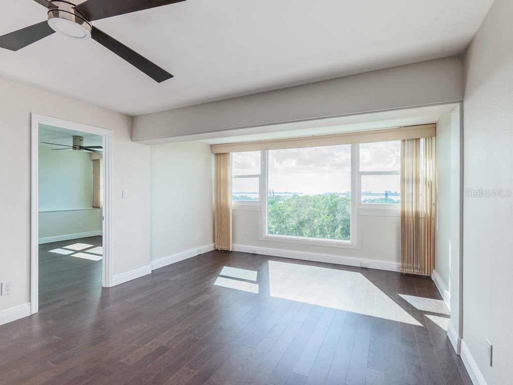 Living Room with direct water views. - Condo for sale at 33 S Gulfstream Ave #706, Sarasota, FL 34236 - MLS Number is A4419314