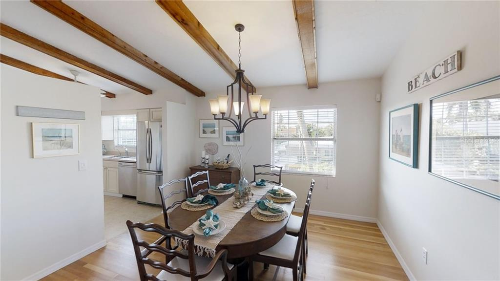 A new Hinkley Lighting chandelier illuminates the generous sized dining area - Single Family Home for sale at 521 75th St, Holmes Beach, FL 34217 - MLS Number is A4420243