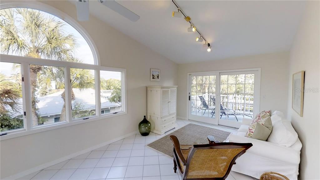 Sliding doors lead to your oversized sun deck - Single Family Home for sale at 521 75th St, Holmes Beach, FL 34217 - MLS Number is A4420243