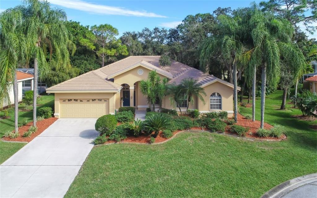 Stunning landscaping with beautiful palm trees. - Single Family Home for sale at 6125 Varedo Ct, Sarasota, FL 34243 - MLS Number is A4420656