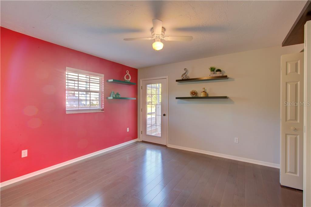 Second spacious bedroom with door leading to the screened in private patio area. - Single Family Home for sale at 5167 Kestral Park Ln, Sarasota, FL 34231 - MLS Number is A4421162