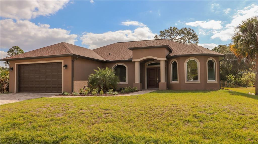 Single Family Home for sale at 11931 Booth Ave, Port Charlotte, FL 33981 - MLS Number is A4421335