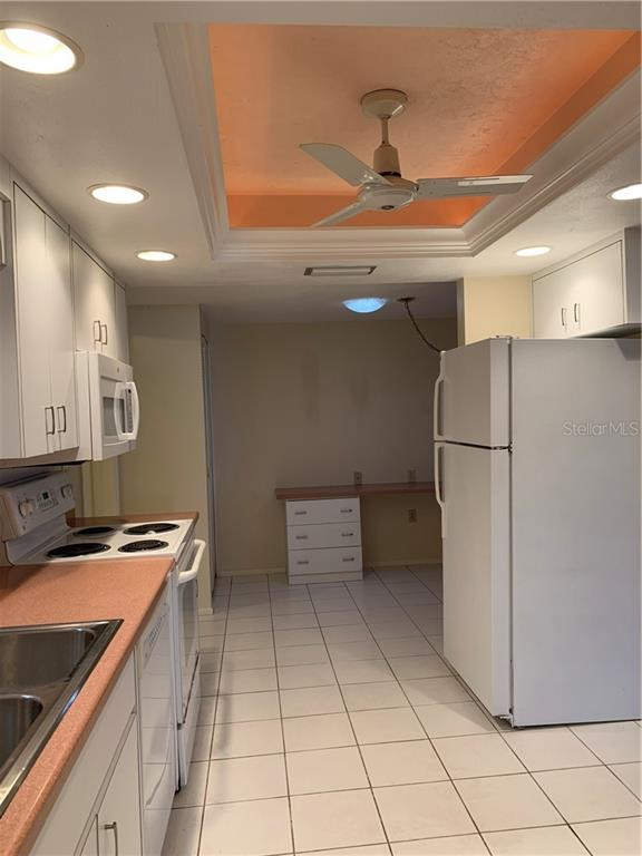 Kitchen to office/breakfast area - Villa for sale at 1528 Stafford Ln #1210, Sarasota, FL 34232 - MLS Number is A4421860