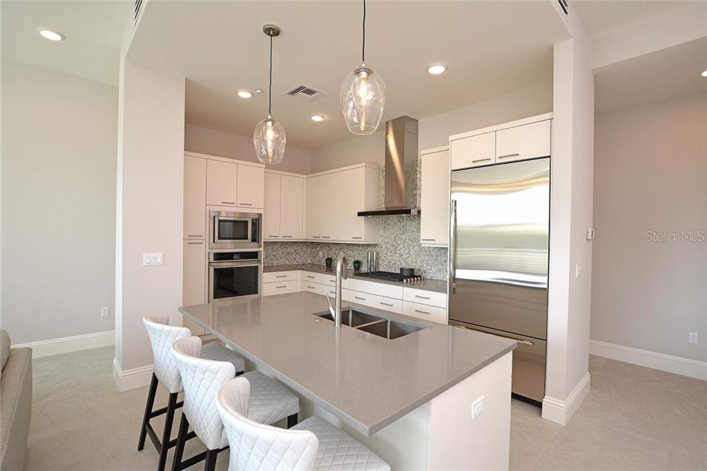 Dining Area - Condo for sale at 609 Golden Gate Pt #201, Sarasota, FL 34236 - MLS Number is A4422340
