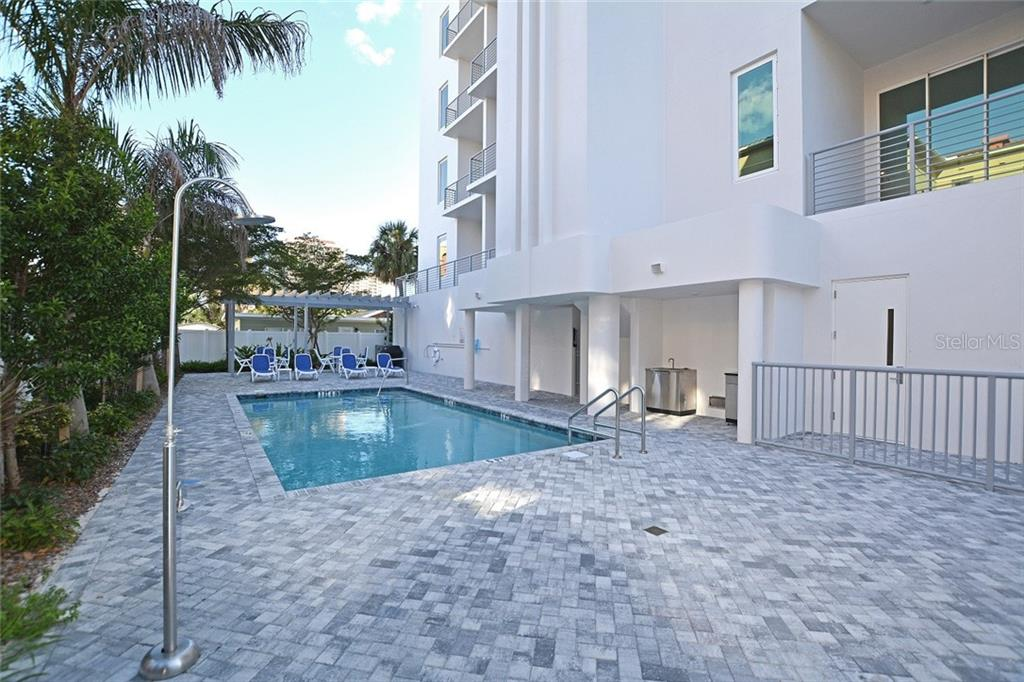 Enjoy the community amenities shared by only 8 residences. - Condo for sale at 609 Golden Gate Pt #301, Sarasota, FL 34236 - MLS Number is A4422419
