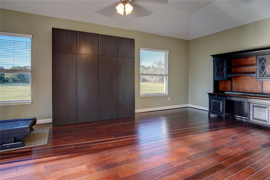 Office with wood floors - Single Family Home for sale at 29425 Saddlebag Trl, Myakka City, FL 34251 - MLS Number is A4422648