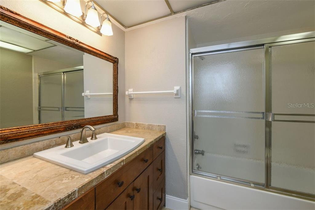 Guest bath. - Villa for sale at 3434 Medford Ln #1110, Sarasota, FL 34239 - MLS Number is A4422897