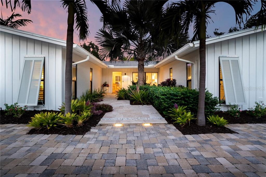 Pristine Coastal Renovation with Bermuda shutters & circular paver drive - Single Family Home for sale at 6957 Belgrave Dr, Sarasota, FL 34242 - MLS Number is A4423362