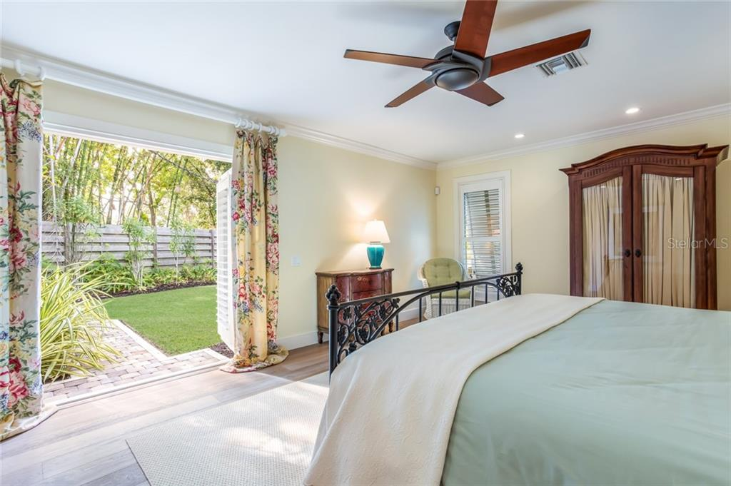 French doors lead to the Garden off the Master bedroom - Single Family Home for sale at 6957 Belgrave Dr, Sarasota, FL 34242 - MLS Number is A4423362