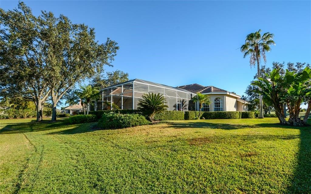Lush green lawn - Single Family Home for sale at 2522 Tom Morris Dr, Sarasota, FL 34240 - MLS Number is A4423908
