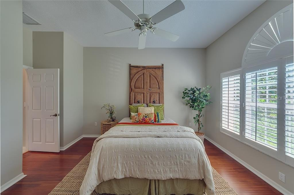 Casita guest bedroom with wood flooring, plantation shutters.  Your guests won't want to leave! - Single Family Home for sale at 2972 Jeff Myers Cir, Sarasota, FL 34240 - MLS Number is A4424133