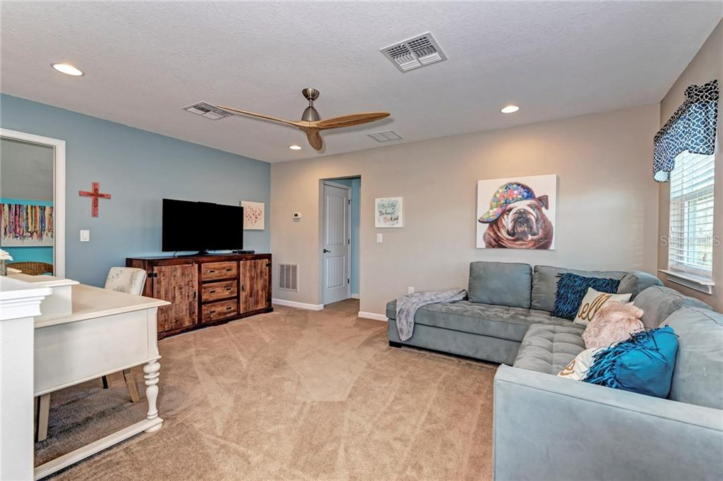 This upstairs loft is the perfect hangout room for your teenagers or grown children living at home! - Single Family Home for sale at 5260 Bentgrass Way, Bradenton, FL 34211 - MLS Number is A4424484