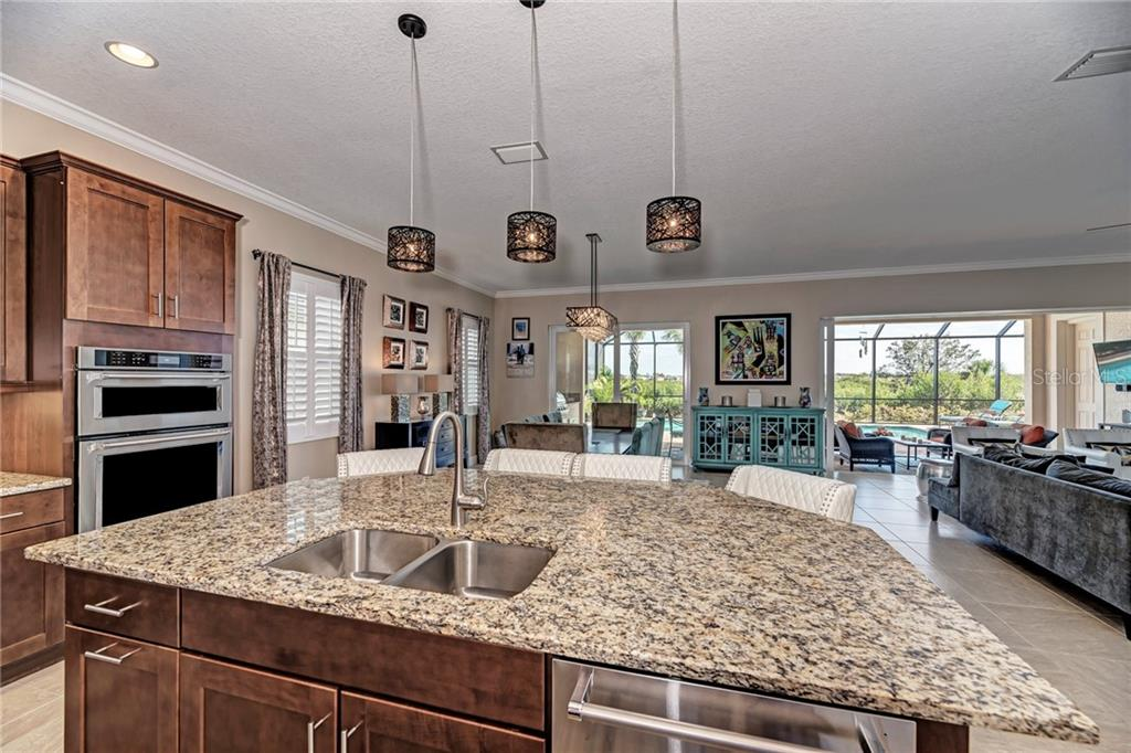 Kitchen island - Single Family Home for sale at 5712 Tidewater Preserve Blvd, Bradenton, FL 34208 - MLS Number is A4424693