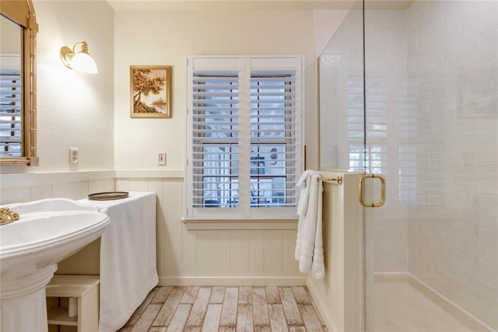 Updated bath with spacious tiled shower - Single Family Home for sale at 422 Garfield Dr, Sarasota, FL 34236 - MLS Number is A4425287