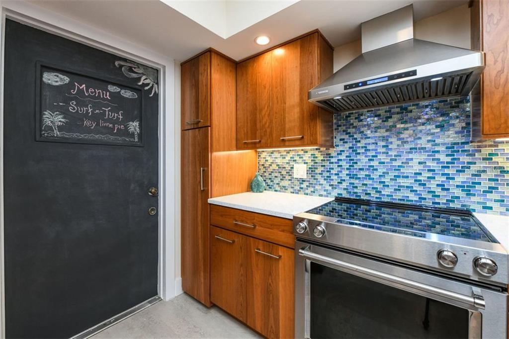 Have fun printing the night's menu on the chalk painted kitchen door! - Condo for sale at 225 Hourglass Way #208, Sarasota, FL 34242 - MLS Number is A4425323