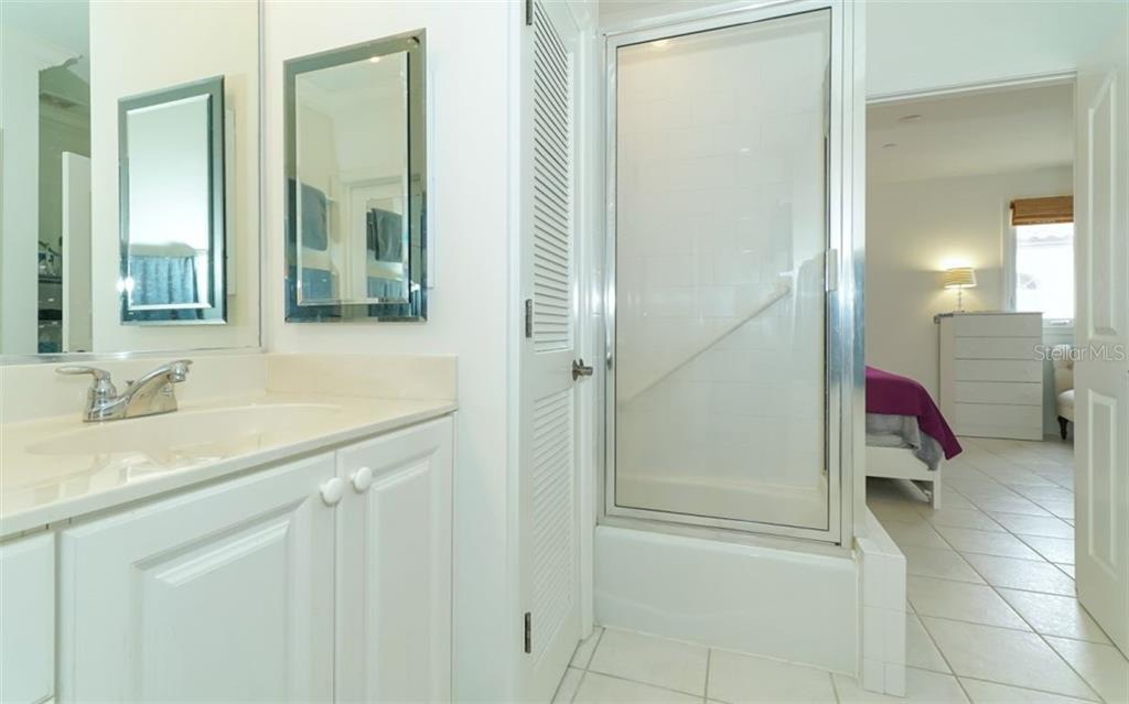 Looking from the master bath into the master bedroom. - Condo for sale at 1283 Fruitville Rd #a, Sarasota, FL 34236 - MLS Number is A4426039