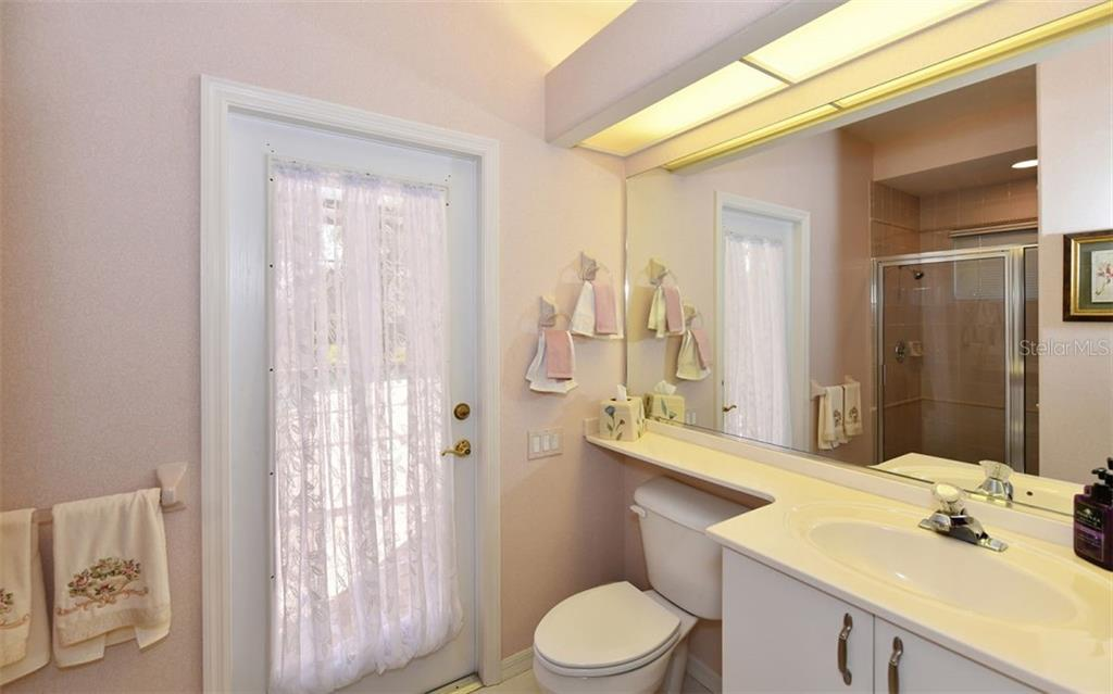 Pool bath that connect to Bedroom 4 - Single Family Home for sale at 7867 Estancia Way, Sarasota, FL 34238 - MLS Number is A4426528
