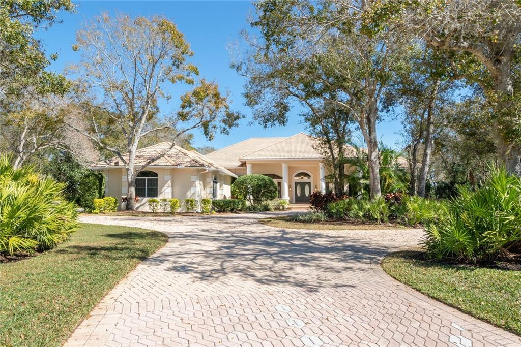 Grand front entry with a pavered drive that has a beautiful roundabout to the right for guests and to the left for the side entry 4-car garage. - Single Family Home for sale at 4931 Ashley Pkwy, Sarasota, FL 34241 - MLS Number is A4426972