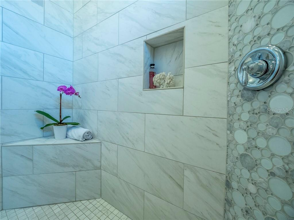 Carrara marble and glass tile mosaic accent walls - Single Family Home for sale at 3611 4th Ave Ne, Bradenton, FL 34208 - MLS Number is A4426978
