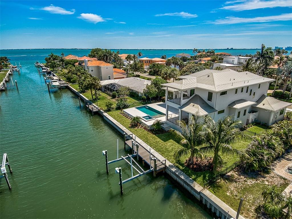 This magnificent new construction, 5 bedroom, 5 full, 2 half bath spacious residence is a dream home in the luxurious Longboat Key, a lush barrier island boasting breathtaking turquoise waters and the home of the renowned Longboat Key Club. - Single Family Home for sale at 537 Yawl Ln, Longboat Key, FL 34228 - MLS Number is A4428503