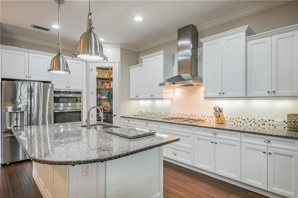 Natural gas cooktop and all cabinets and drawers are all soft-close. - Single Family Home for sale at 595 Fore Dr, Bradenton, FL 34208 - MLS Number is A4428657