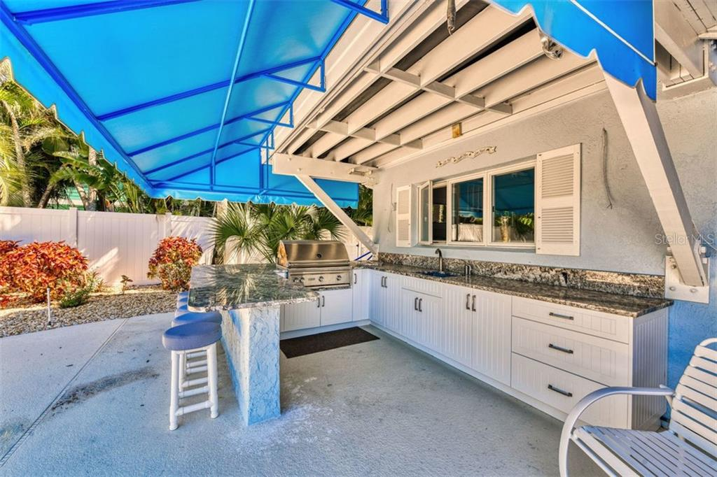 Gracious entertaining and memory collections begin at this outdoor kitchen - Single Family Home for sale at 737 Eagle Point Dr, Venice, FL 34285 - MLS Number is A4428917