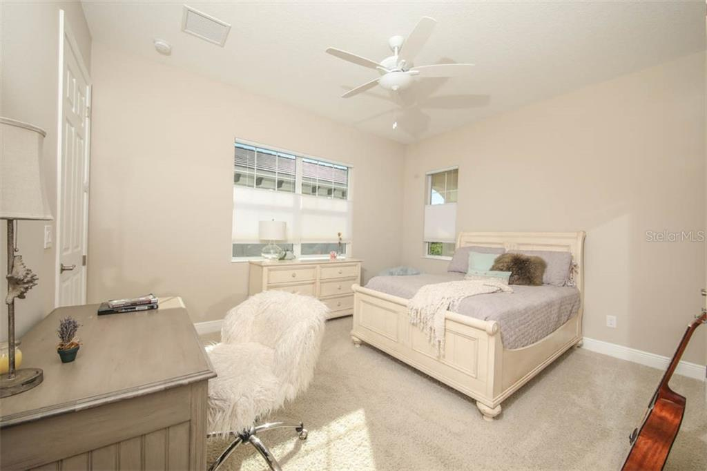 Bedroom 2, downstairs - Single Family Home for sale at 5504 Tidewater Preserve Blvd, Bradenton, FL 34208 - MLS Number is A4429479