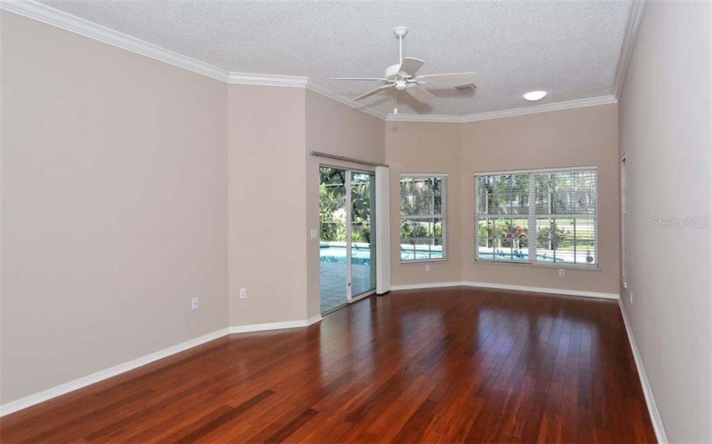 The first floor Master Suite offers lanai access as well as three closets with lots of extra storage. - Single Family Home for sale at 1636 Liscourt Dr, Venice, FL 34292 - MLS Number is A4429524