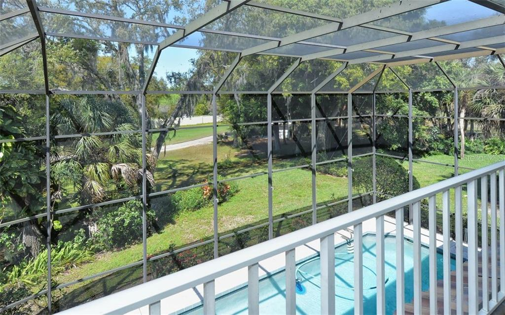 The upstairs patio has beautiful pool and golf course views - Single Family Home for sale at 1636 Liscourt Dr, Venice, FL 34292 - MLS Number is A4429524