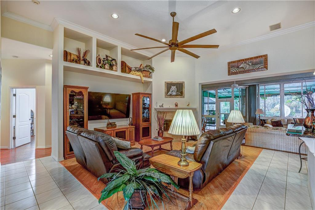 Huge versatile great room with ten foot ceiling fan, surround/patio speakers, and smart house technology - Single Family Home for sale at 6321 W Glen Abbey Ln E, Bradenton, FL 34202 - MLS Number is A4429610