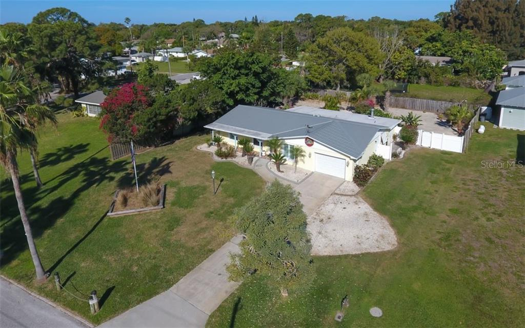 Facing south to Dona Bay, this home sits on a large lot with fenced backyard. - Single Family Home for sale at 310 Bayview Pkwy, Nokomis, FL 34275 - MLS Number is A4430065