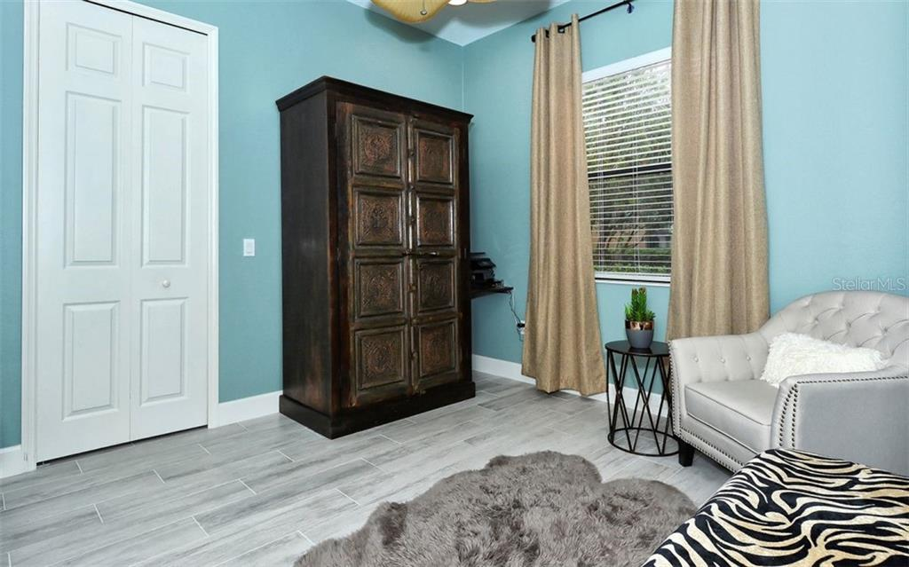 Bedroom 2 - Single Family Home for sale at 14231 Sundial Pl, Lakewood Ranch, FL 34202 - MLS Number is A4430945