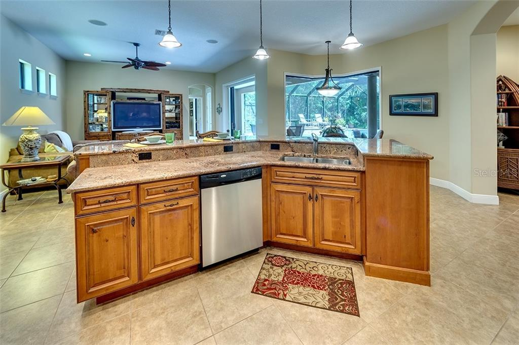 Kitchen island w/view into family room - Single Family Home for sale at 3753 Eagle Hammock Dr, Sarasota, FL 34240 - MLS Number is A4431001