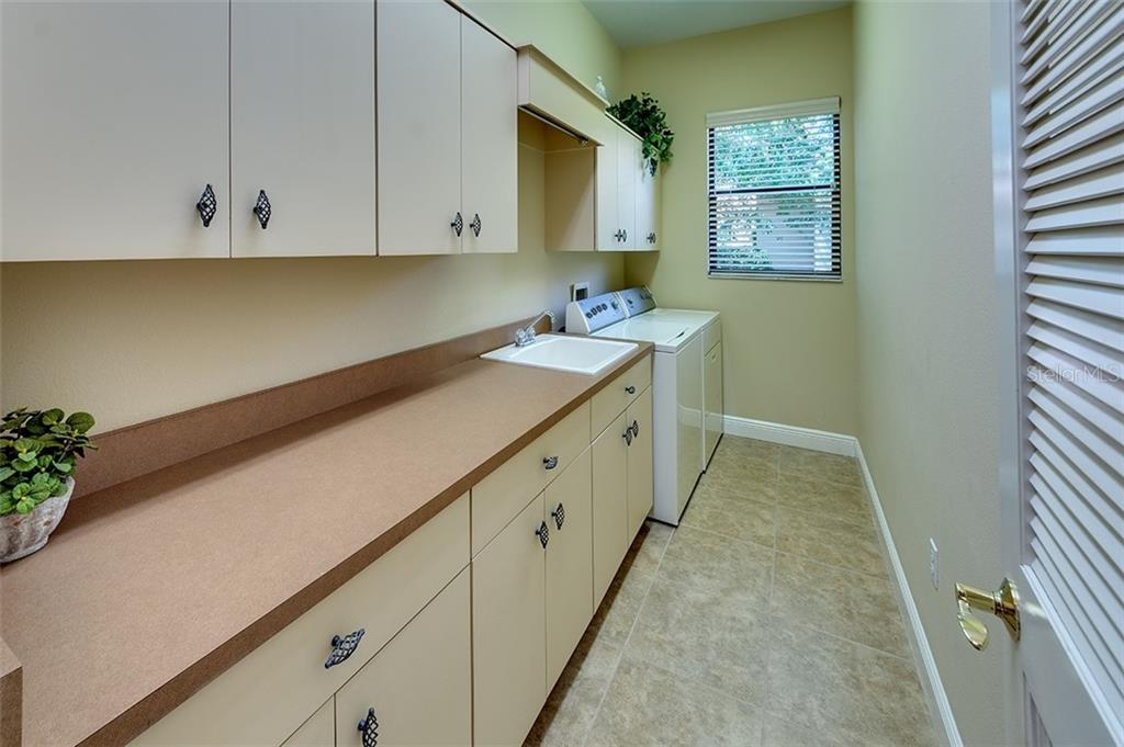 Bright laundry room - Single Family Home for sale at 3753 Eagle Hammock Dr, Sarasota, FL 34240 - MLS Number is A4431001