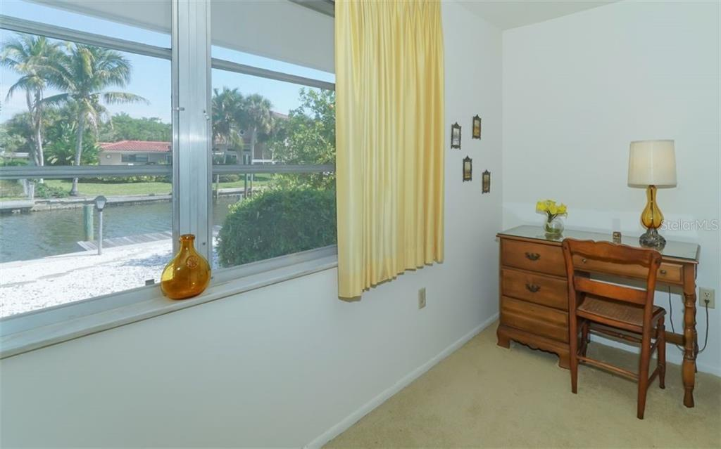 Master Bedroom and view of Canal - Single Family Home for sale at 935 Contento St, Sarasota, FL 34242 - MLS Number is A4431223