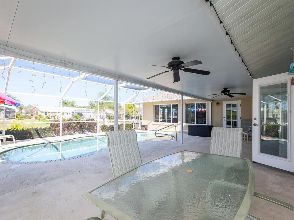 BIG pool deck!  multiple eating and gathering area's great for entertaining. - Single Family Home for sale at 4908 Coral Lake Dr, Bradenton, FL 34210 - MLS Number is A4431516